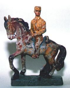 This is an SA man (Sturm Abteilung - storm trooper) made in Germany during the 1930s by LEYLA, one of the smaller manufacturers. The swastika on his red armband has been scratched off, which is common on such figures of this period as it was illegal to show this symbol in Germany for several decades after the war. This is a one piece casting and the style is reminiscent of earlier ornamental ceramic figures. The smaller manufacturers are not widely collected, and the sculpting is generally…