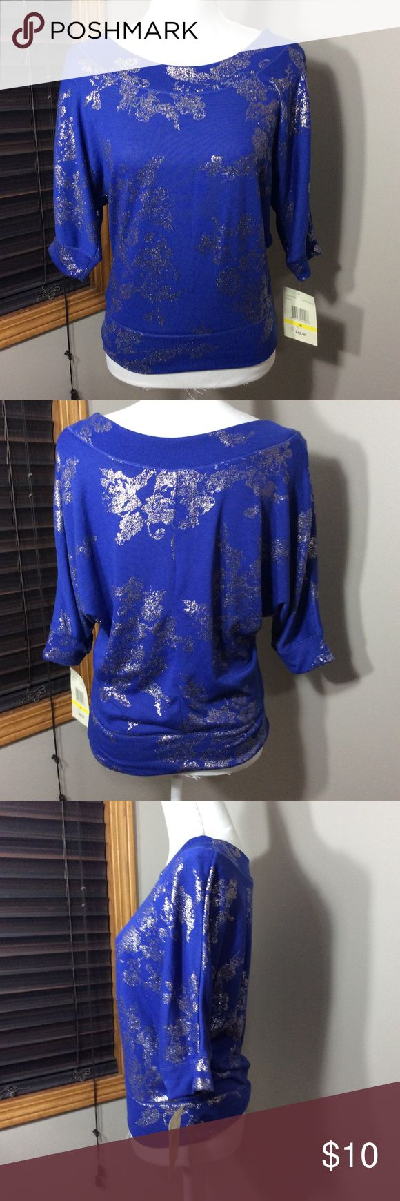 Super cute top Brand new with tags purple & silver batwing top. Bundle for more discount Eyeshadow Tops Blouses