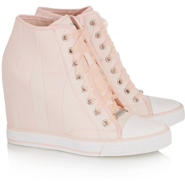 DKNY Grommet appliquéd canvas wedge sneakers ($110) ❤ liked on Polyvore featuring shoes, sneakers, wedge trainers, hidden wedge heel sneakers, canvas lace up shoes, zipper sneakers and pink sneakers