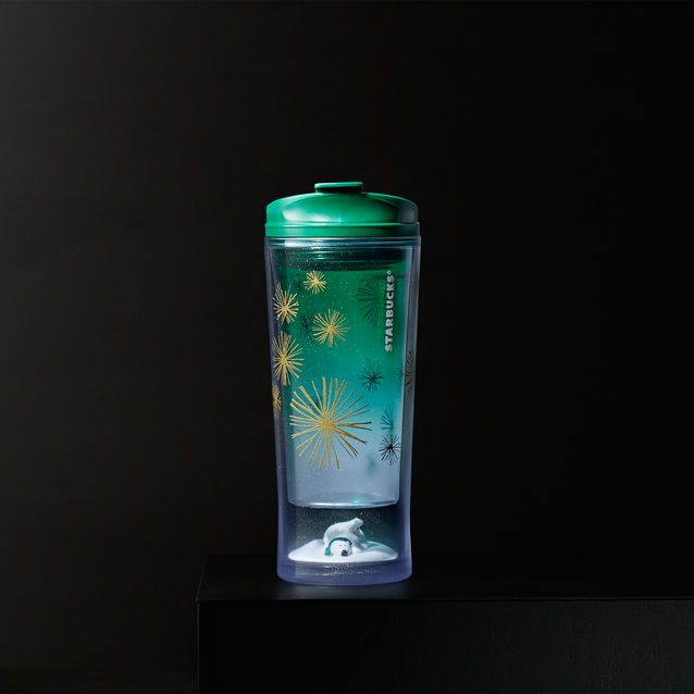 A sparkly acrylic tumbler with a polar bear and cub in the snow peeking out from the bottom.
