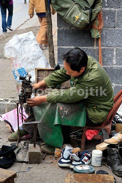 Street shoe fixer, Fenghuang Town, Hunan, China