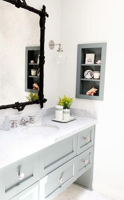 Modern rustic gray and black bathroom: http://www.stylemepretty.com/living/2016/11/02/giving-an-outdated-bathroom-a-stunning-and-timeless-makeover/ Photography: Sabra Lattos - http://sabralattos.com/