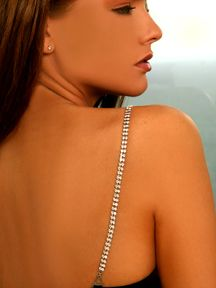 """Adjustable bra straps with approximately 140 round brilliant Swarovski crystals of 3 mm diameter stones in each strap. Hypoallergenic nickel free silver jewelry. Wide:2/8"""", Total Length:17.7"""" (including 4"""" adjuster Chain). Elegant jewelry box and pouch included."""