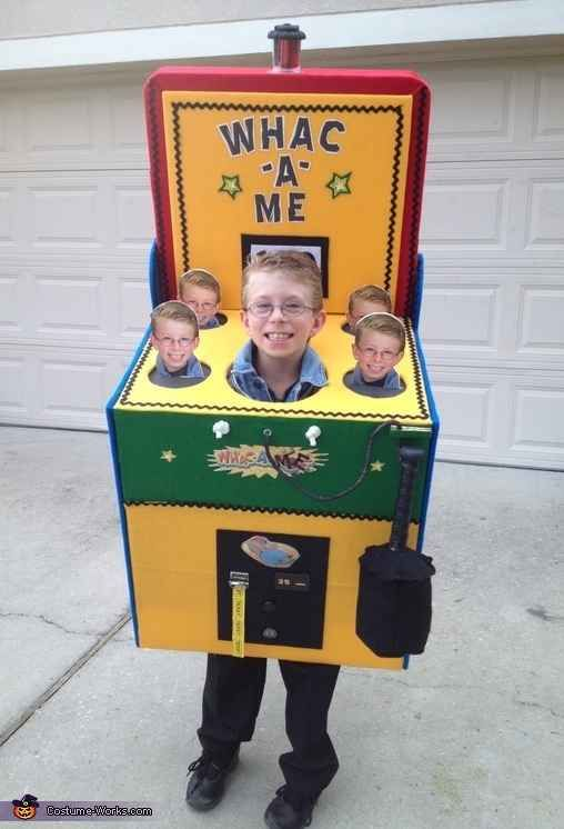 This boy turned walking arcade game. | 23 Kids Who Are Totally Nailing This Halloween Thing