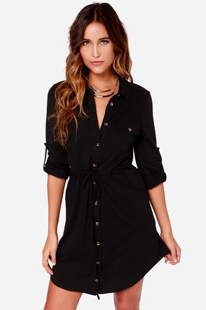 """LuLu*s Exclusive! Bring a touch of darling to your daily routine with the Brave and the Bold Long Sleeve Black Shirt Dress! This hybrid brings all your favorite features of an oversized shirt to a knit dress, with a collared neckline, front placket, and buttoned flap pocket. The long cuffed sleeves have button tabs to let you choose between full or three-quarter sleeves, and the drawstring waist synches and ties above two front pockets. Unlined. Model is 5'8"""" and wearing a size X-Small. 75%…"""