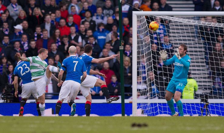 Celtic's Leigh Griffiths heads the ball past Rangers keeper Steve Simonsen to open the scoring