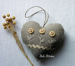 heart with folk art stitched button flowers