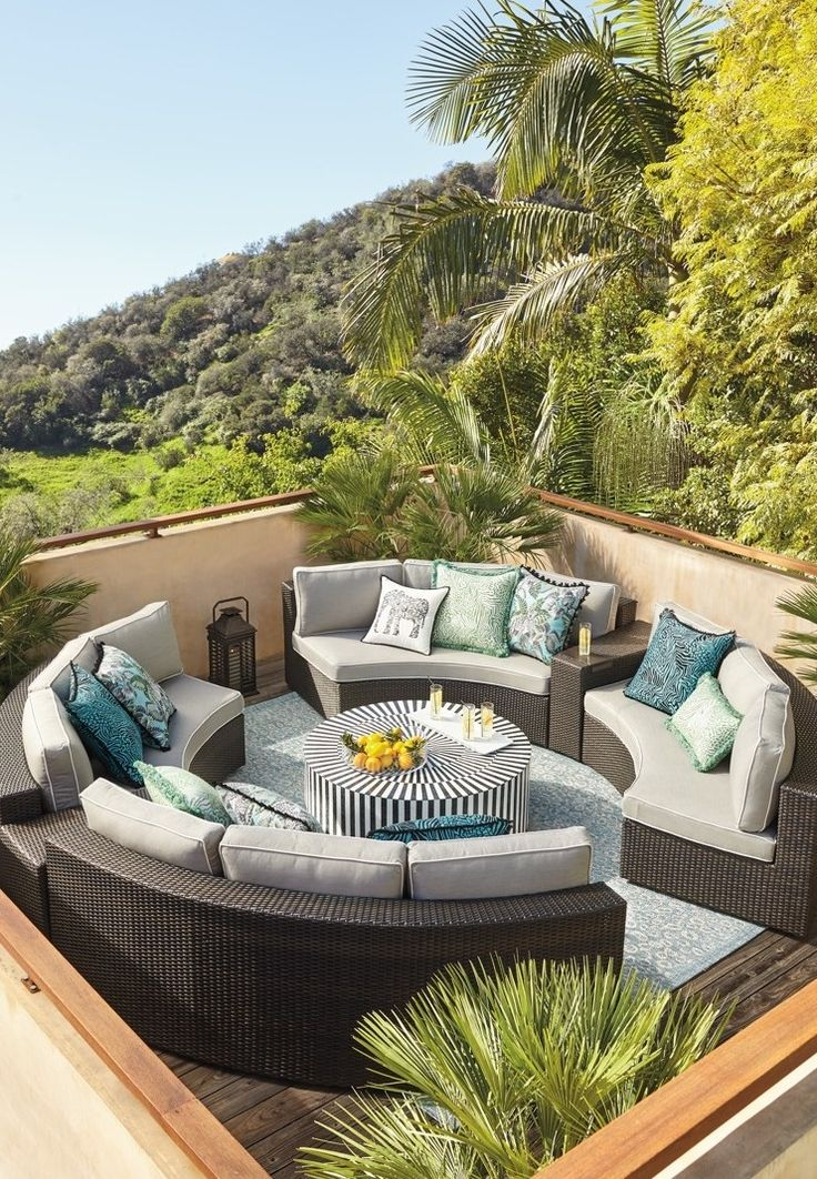 Comfortable cushioned pieces in circular formation make it easy for the Pasadena Modular Collection to create the ultimate open-air chat room.