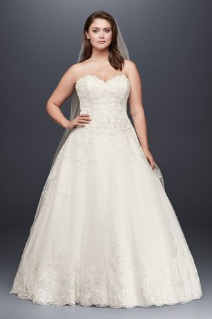 This romantic plus size ball gown features beaded lace appliques that begin on the strapless bodice and cascade onto the floaty tulle skirt. A beaded hemline finishes the dress with soft sparkle.  Jewel, exclusively at David's Bridal  Plus size  Polyester  Chapel train  Back zipper; fully lined  Dry clean  Imported  Also available in regular, petite, extra length and plus size extra length
