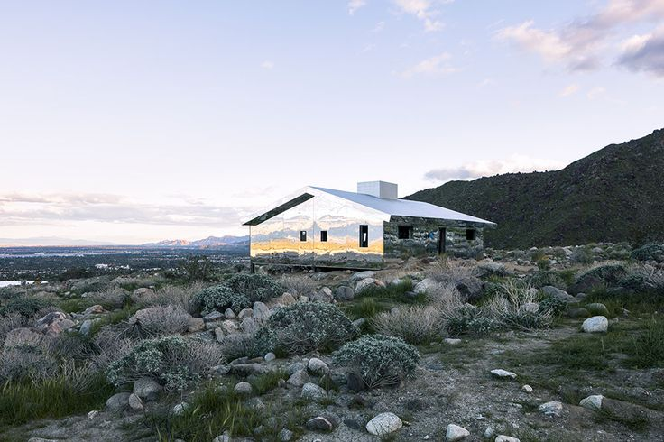 Perched at the juncture where the San Jacinto mountains open into the Coachella valley in California, artist Doug Aitken has erected a ranch-style suburban home covered entirely in mirrors. Titled Mirage, the house appears like an inverted kaleidoscope, reflecting everything from the sky above to th