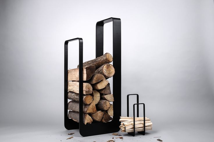 Elegant firewood rack from designers & craftsmans duo Uhrecki. Matt Black powder coating