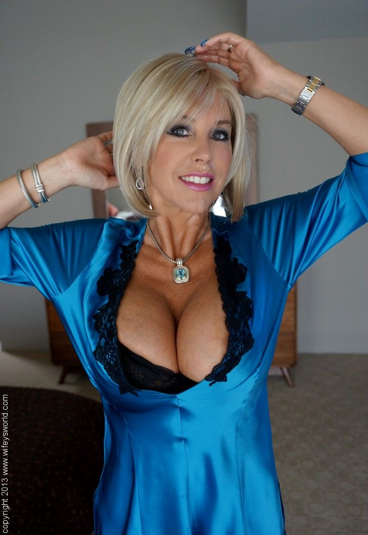 Blonde older women flashing tits