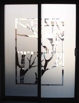 custom tree graphic in frost on window for privacy