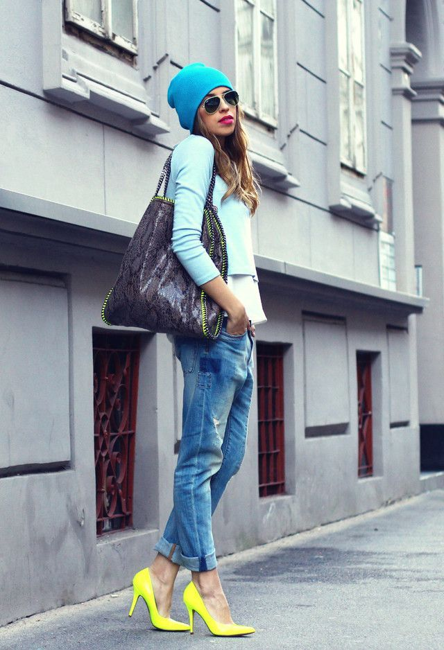Shop this look on Lookastic:  http://lookastic.com/women/looks/beanie-sunglasses-pumps-boyfriend-jeans-crew-neck-t-shirt-cropped-sweater-tote-bag/4676  — Aquamarine Beanie  — Green Sunglasses  — Yellow Leather Pumps  — Blue Ripped Boyfriend Jeans  — White Crew-neck T-shirt  — Light Blue Cropped Sweater  — Violet Snake Leather Tote Bag