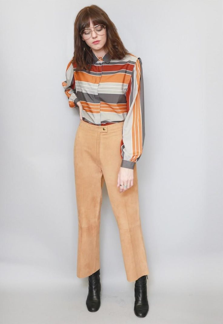 """Vintage 1970's Caramel Brown Suede Trousers. Amazing soft brown luxurious suede. Feature a straight leg and a zip front fastening. The trousers are a UK  10-12 approx. Please see sizing for measurements. Our model is a size 8. If you love Peekaboo, """"follow"""" us here on ASOS. First-time buyers will receive a discount code and you will also be kept up-to-date with our daily arrivals. Our hassle-free returns means you can shop with ease. Lots of Love Peekaboo xx"""