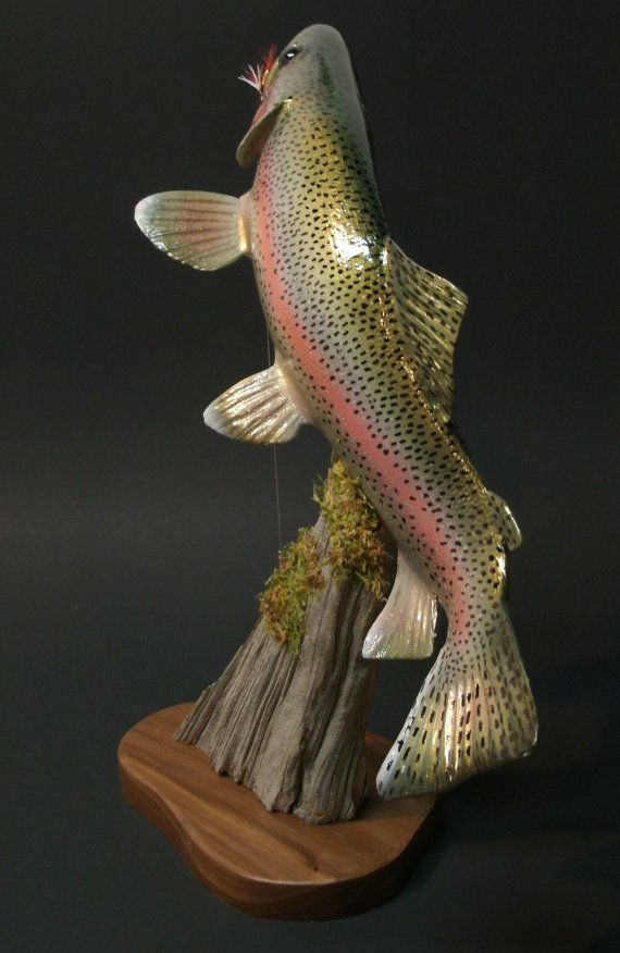A one of a kind trout sculpture by Marc DeMott. Sure would look good in my…