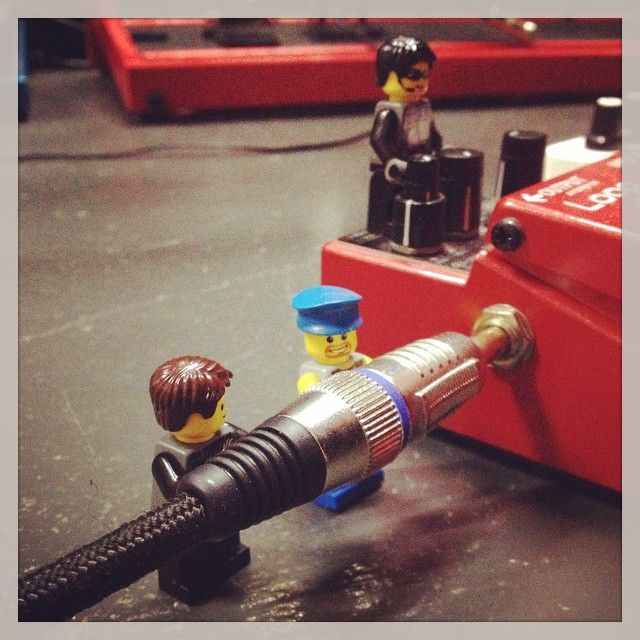Team Lego connect a guitar lead to a BOSS pedal. Go team!
