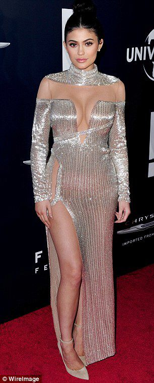 Kylie Jenner flashes her distinctive thigh scar in metallic dress #dailymail