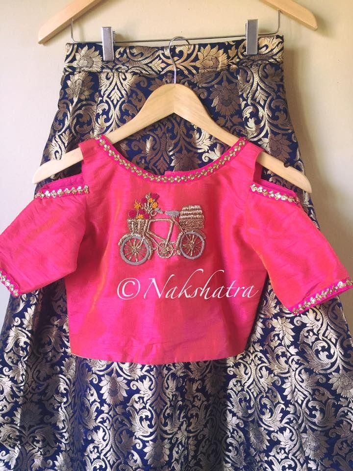 Western cycle embroidery design on clod shoulder blouse with benarasi lehanga from Nakshatra. 18 April 2017