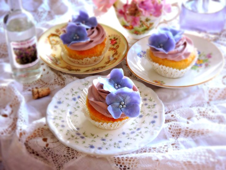 Vanilla cakes with lavender liqueur butter cream with handmade hydrangea inspired sugar flowers. #lavender  #cupcakes #lavender #liqueur #buttercream #hydrangea #sugar #flower