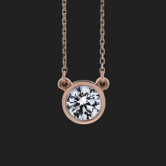 "This classic Bezel Pendant is ready to ship, set with a 1.0ct Round Brilliant center stone on a 16 inch, 1.4mm 14K Rose Gold chain. |This pendant is the perfect gift for any occasion; anniversary, birthday, holiday, or ""just because"".