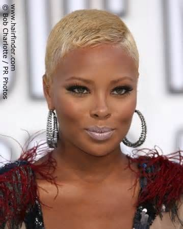 eva marcille - the blond unexpectedly works with her bronzed skin, especially with the lightened eyebrows. Can't say the same for that frosted lipstick, though.
