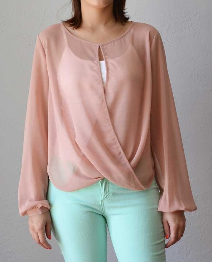 Sheer chiffon blouse featuring long sleeves and overlapping drape on front in dusty rose. Available at Love Shopping Miami