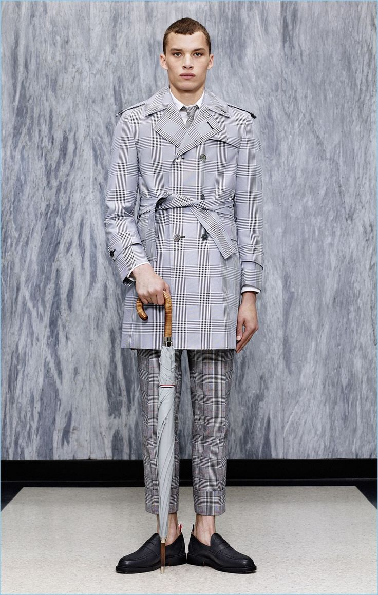 Louis Mayhew dons a trench coat and cropped trousers from Thom Browne's  spring-summer 2017