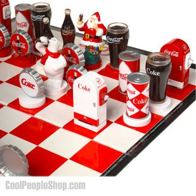 COCA COLA Chess Board Game features the red COCA-COLA team vs white COKE team. Custom pieces feature classic COCA-COLA icons. The ultimate game of strategy, Chess, showcases the red COCA-COLA team led by Santa matching wits with the white COKE team headed by the Polar Bear.