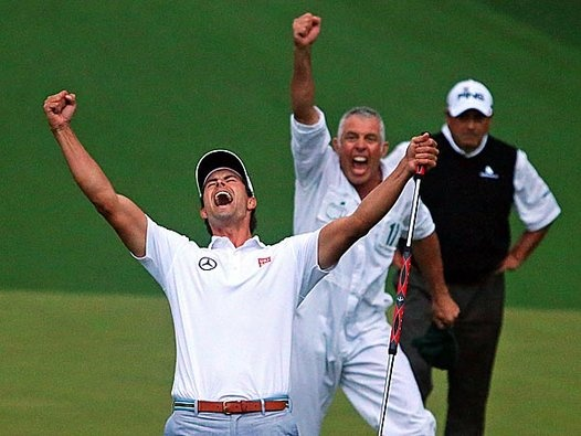 adam scott, golfer   Adam Scott and his caddie Steve Williams reacts to his putt dropping ...