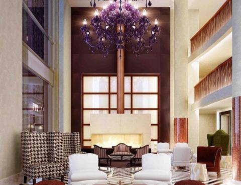 Gansevoort Park NYC - Love the lobbies HUGE purple chandelier and crystal fireplace