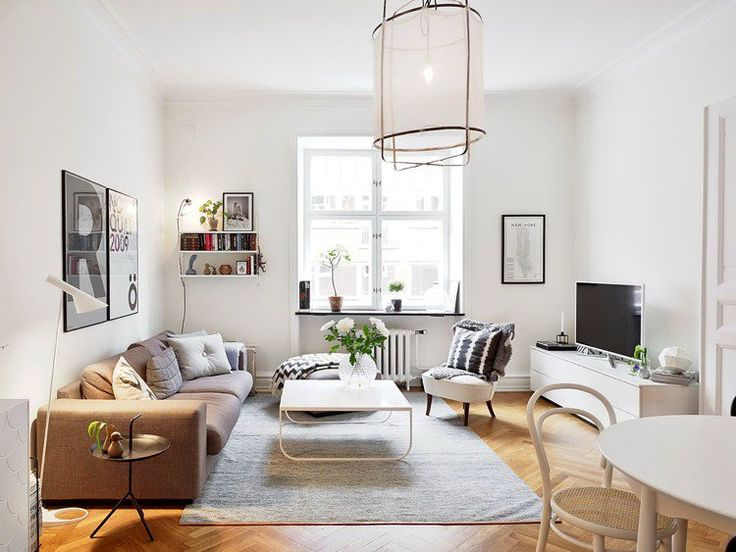 aménagement de salon -cnapé-marron-clair-table-basse-blanche-tapis-gris
