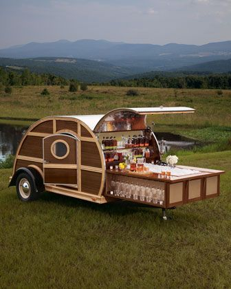 Bulleit Frontier Whiskey Woody-Tailgate Trailer. Are you looking at this thing? It's a portable bar trailer. Forget about warm beer and Doritos for your next tailgate party–in addition to fancy whiskey and glassware, it includes a TV, Blu-ray player, and sound system.