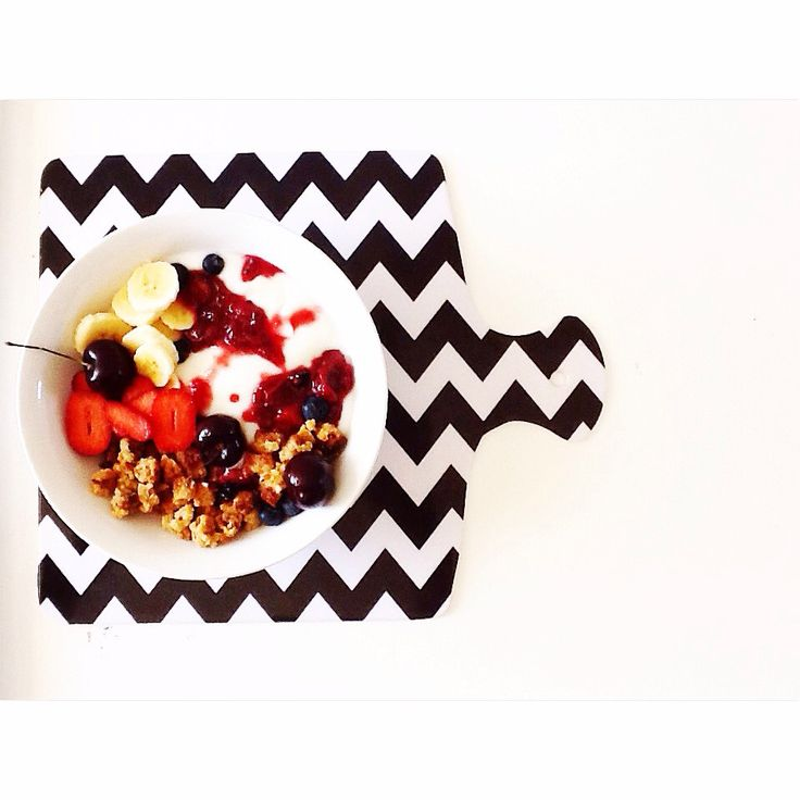 Homemade coconut x granola clusters w some stewed berries and yoghurt