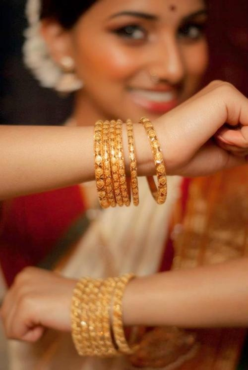 Gold bangles. Jasmine flowers. South Indian-ness :) it's all about the bangles!