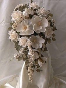 Magnolia wedding flowers.  We can add Roses and Hydrangea's to this bouquet.  How about bridesmaids with pretty bright colors minus the Hydrangea's.  Let's think about this one.  Pretty aren't they?