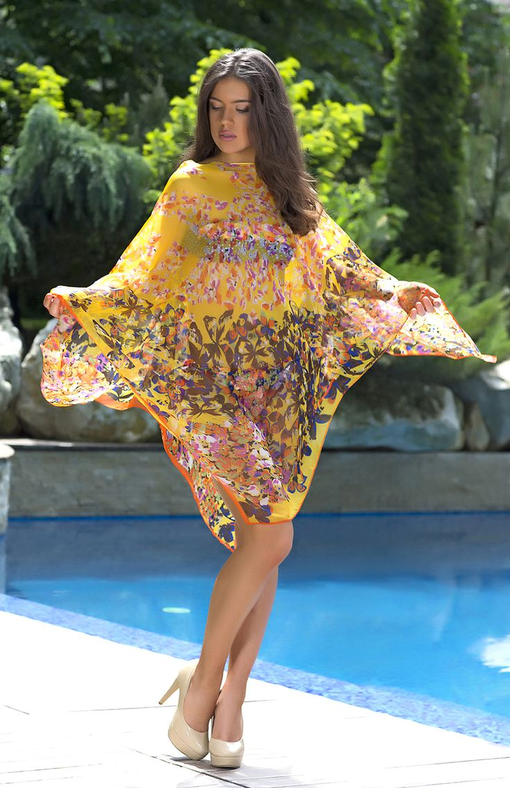 A pretty and feminine beach cover-up. This floral beach dress in a vibrant shade of yellow is sure to look great in the sunshine! A timeless holiday choice.