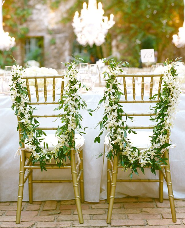 Aaron Delesie Photography // The Knot Blog white orchid and vine lei draped chairs