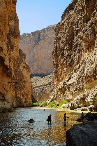 wading in the Rio Grande River as it passes through the Santa Elena Canyon, Big Bend National Park, Texas
