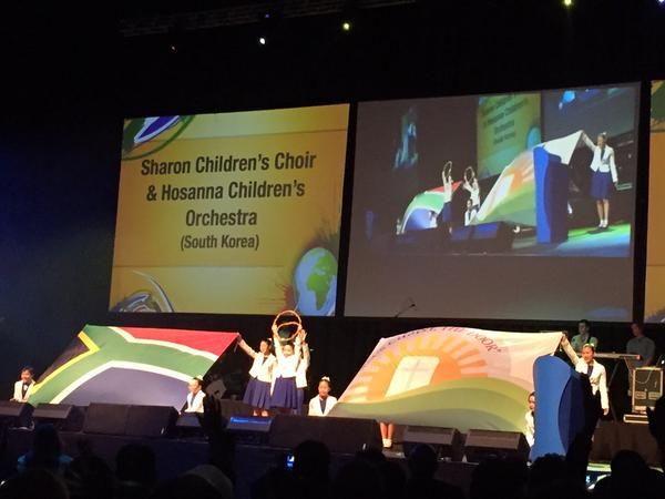 The Sharon Children's Choir and Hosanna Children's Orchestra from South Korea lead in worship during the opening session of the BWA's 2015 World Congress in Durban. Photo by Helle Liht.