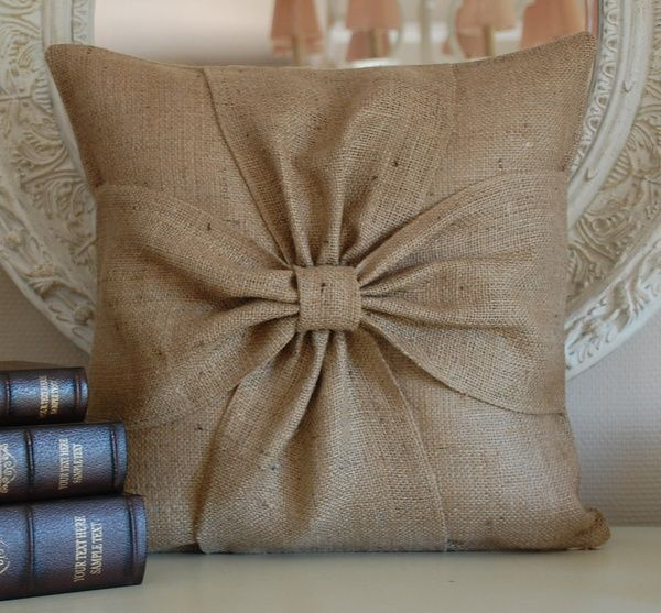 Burlap bow pillow. I love it! I wonder if this would be possible to make.