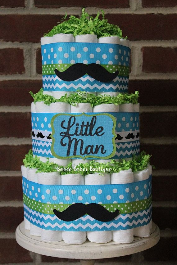 This 3 tier diaper cake will be the perfect centerpiece at your baby shower! This cake comes with 64 size 1 Pamper swaddlers and measures 15