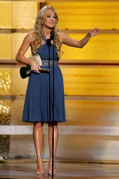 Carrie Underwood Photos Photos - Singer Carrie Underwood accepts the 'Top Female Vocalist' award onstage during the 42nd Annual Academy Of Country Music Awards held at the MGM Grand Garden Arena on May 15, 2007 in Las Vegas, Nevada. - 42nd Annual Academy Of Country Music Awards - Show