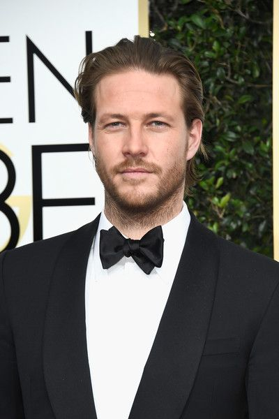 Luke Bracey Photos - Actors Luke Bracey attends the 74th Annual Golden Globe Awards at The Beverly Hilton Hotel on January 8, 2017 in Beverly Hills, California. - 74th Annual Golden Globe Awards - Arrivals