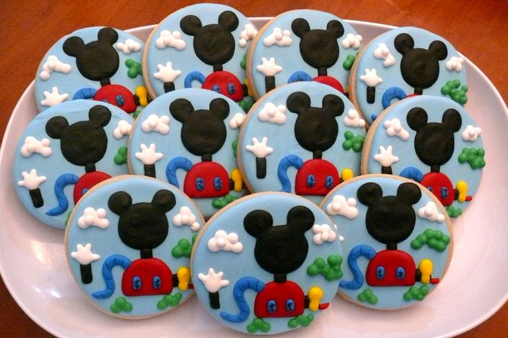 Mickey Mouse Clubhouse (Disney) decorated cookies to use as favors at a birthday party.  www.facebook.com/cookiesbycharity
