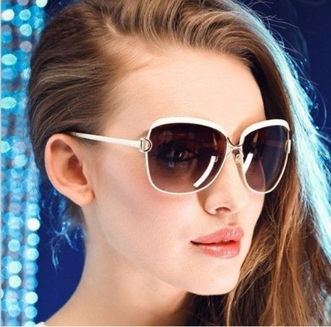 Talk about classy! We absolutely love these uniquely shaped sunglasses! This beauty has been spotted on several of the hottest celebrities. Team them up with any outfit and style your hair in a tight bun to get the complete look!   Full protection against ultraviolet light Lenses block 99% or 100% of UVB and UVA rays Lenses meet ANSI  blocking requirements.  UV 400 protection. (These block light rays with wavelengths up to 400 nanometers, which means that your eyes are shiel