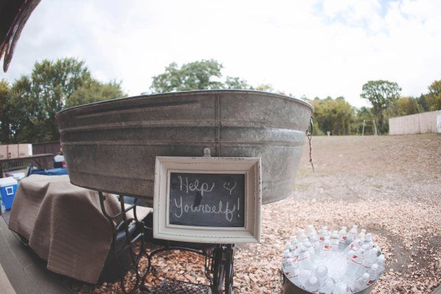 rustic water bottle troff with chalkboard sign | Minnesota Wedding | Photo courtesy Jess Crowshaw Photography