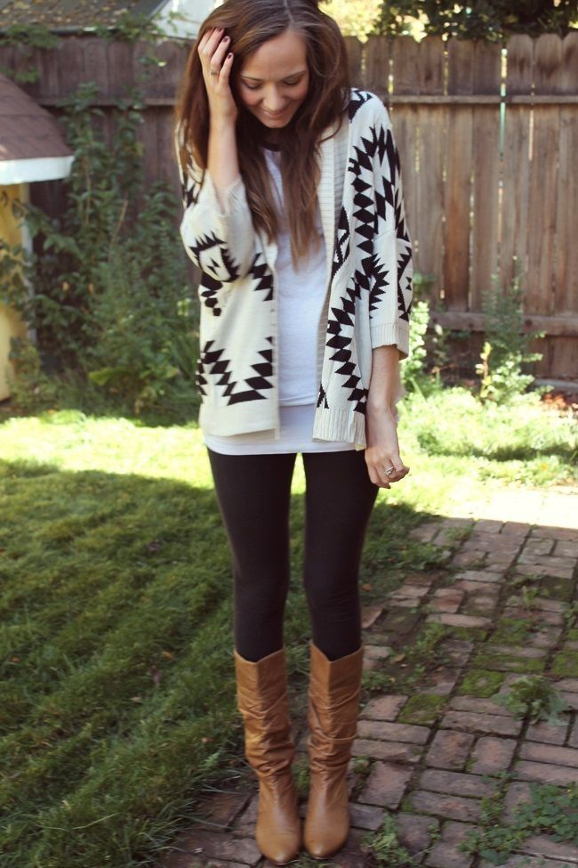 White and black Aztec cardigan, black leggings, tan boots