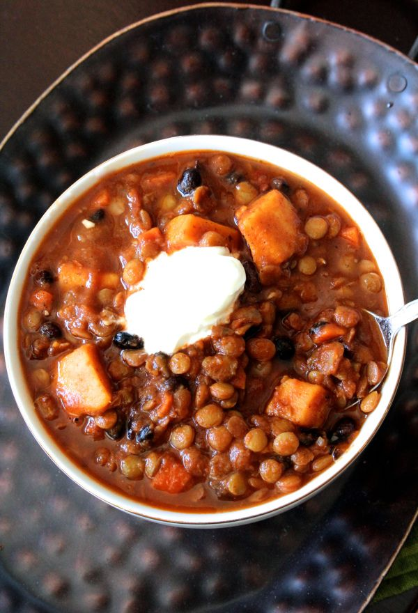 This sweet potato, black bean, and lentil chili so hearty that you'll never miss the meat! Healthy comfort food at its finest, and it's simple to make.