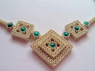 Seed beads and larger bead. M.